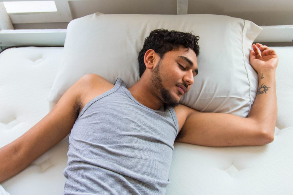 Man getting quality sleep on foam mattress and pillow.